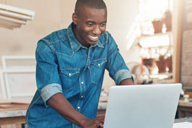 african american man working on laptop